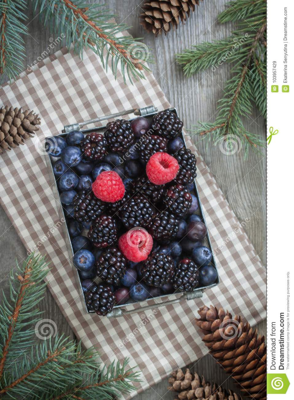 Fresh Berries In The Iron Box On The Beige Napkin With Cones And Christmas Tree Branches Rustic Background Stock Image Image Of Fresh Health 103957429