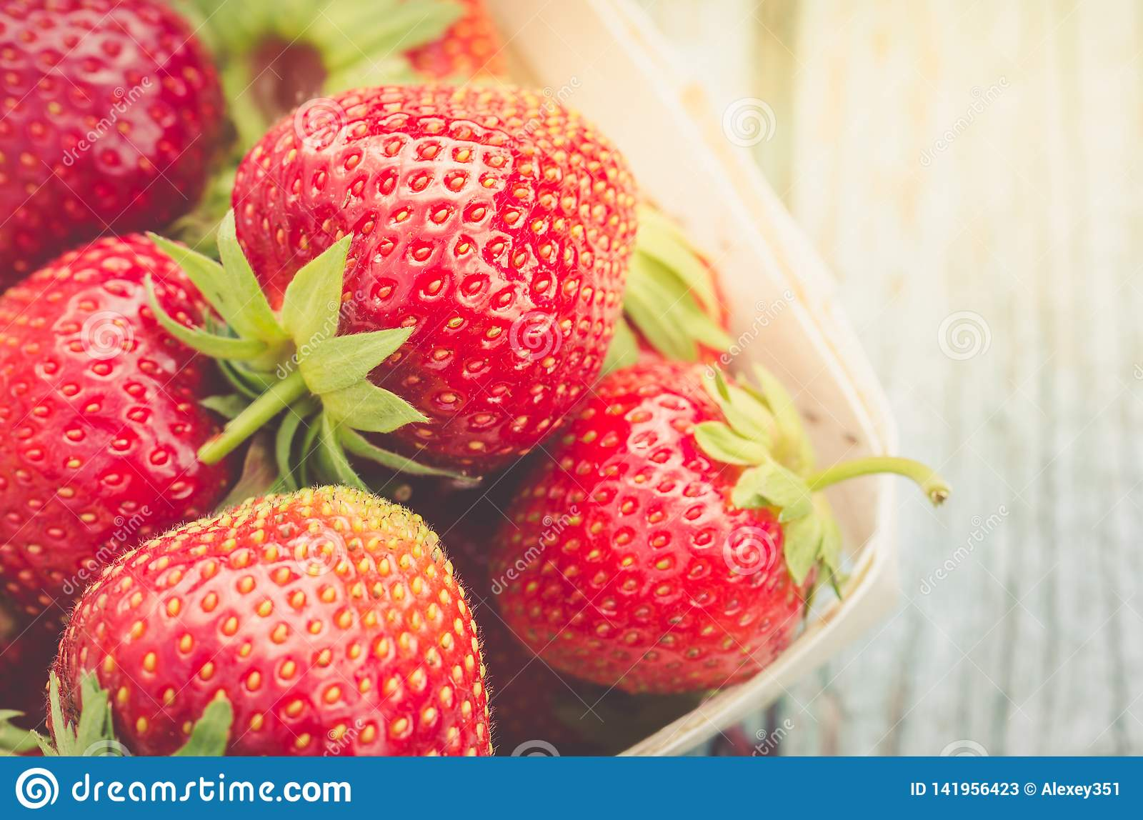 Fresh berries of strawberry/Top view. Fresh strawberry in wooden basket in sunlight. Closeup