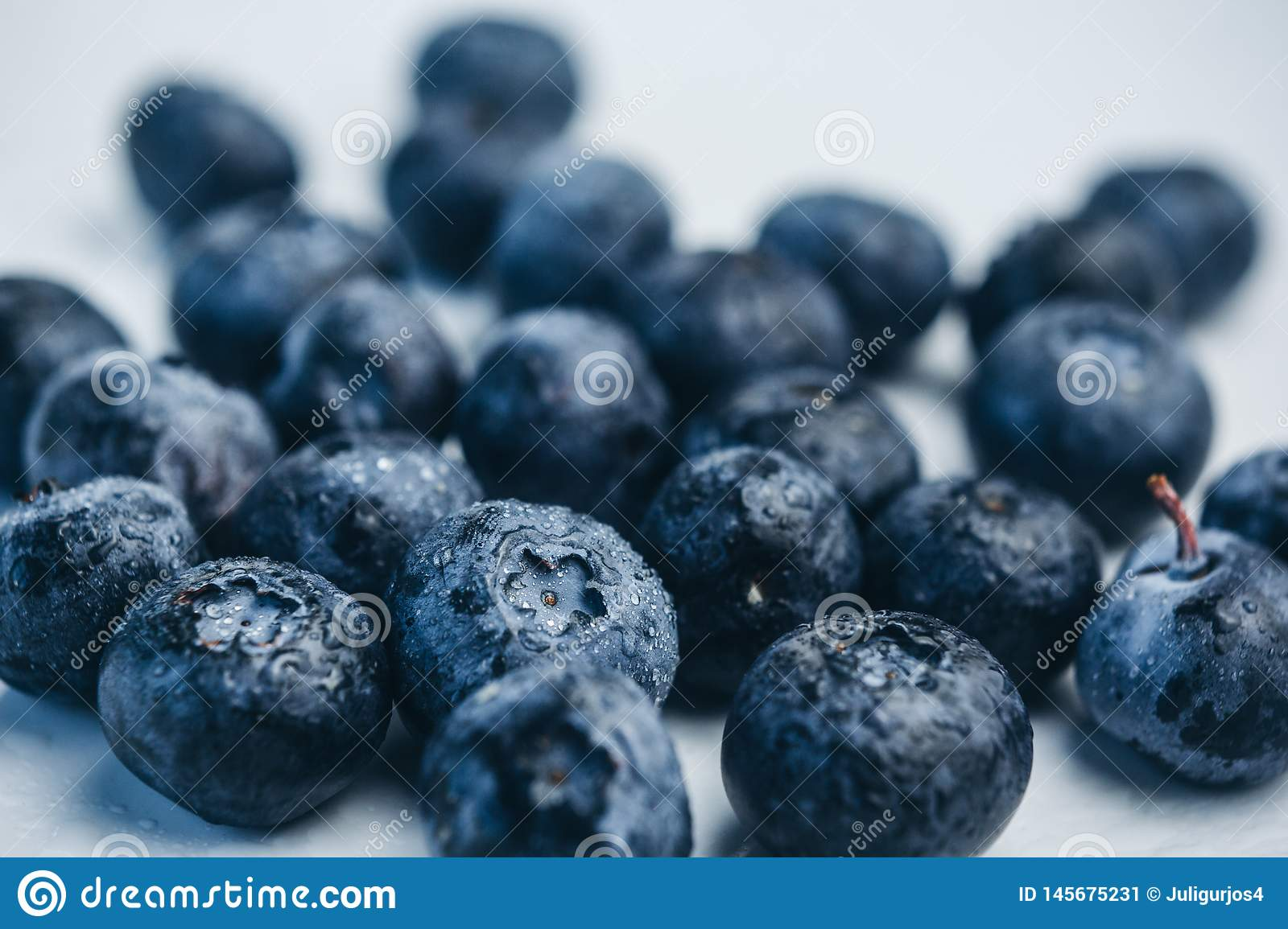 Fresh blueberry berries on a white plate close-up. breakfast of wild berries. copy space