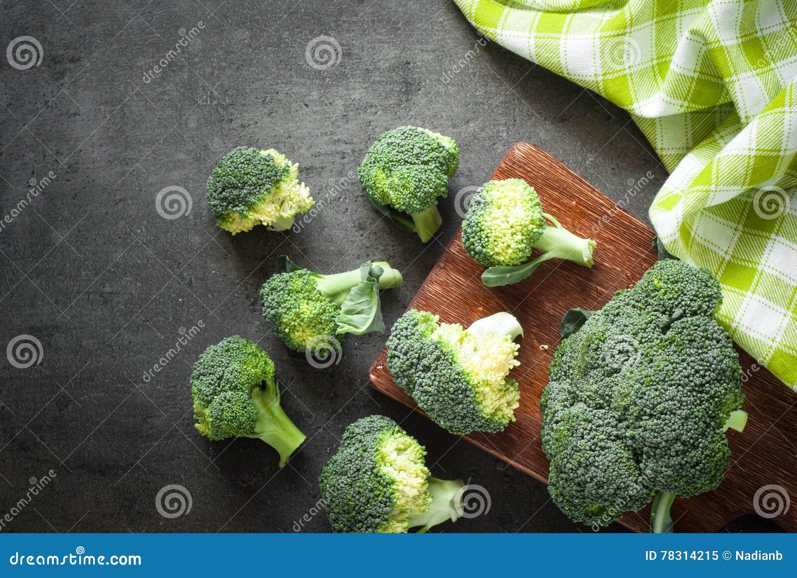 Fresh broccoli at dark table.