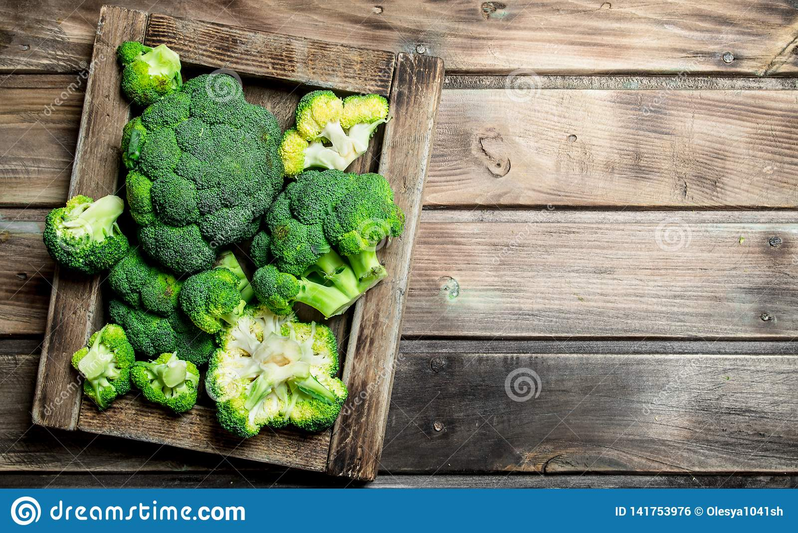 Fresh broccoli in a wooden box