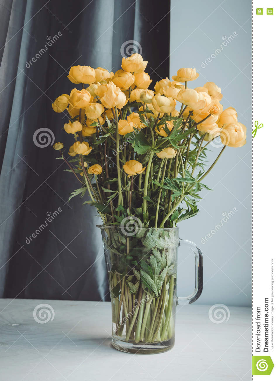 Fresh bunch of yellow summer flowers in glass vase on a white fresh bunch of yellow summer flowers in glass vase on a white windowsill background cozy home rustic style decor still reviewsmspy