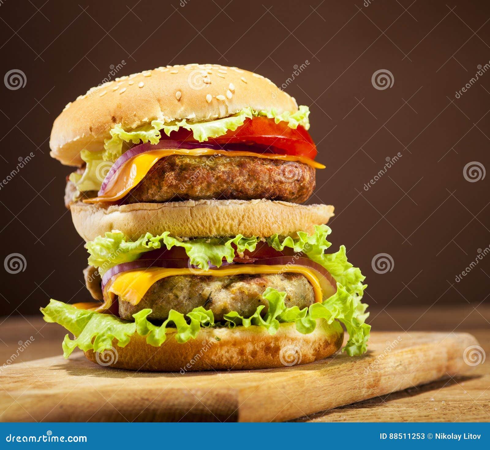 Background image 8851 - Fresh Burger On Wooden Background Stock Photo