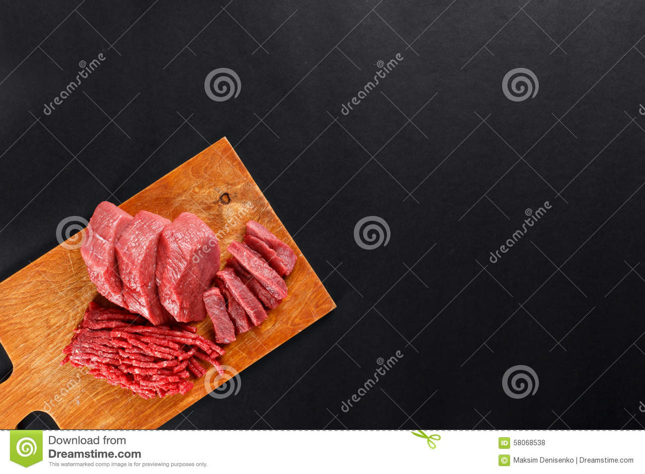 Fresh butcher cut meat assortment on black background