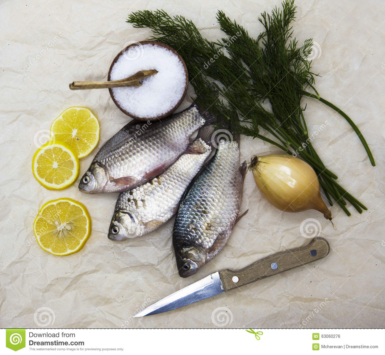 A fresh carp live fish lying on a on paper background with for Live fish online