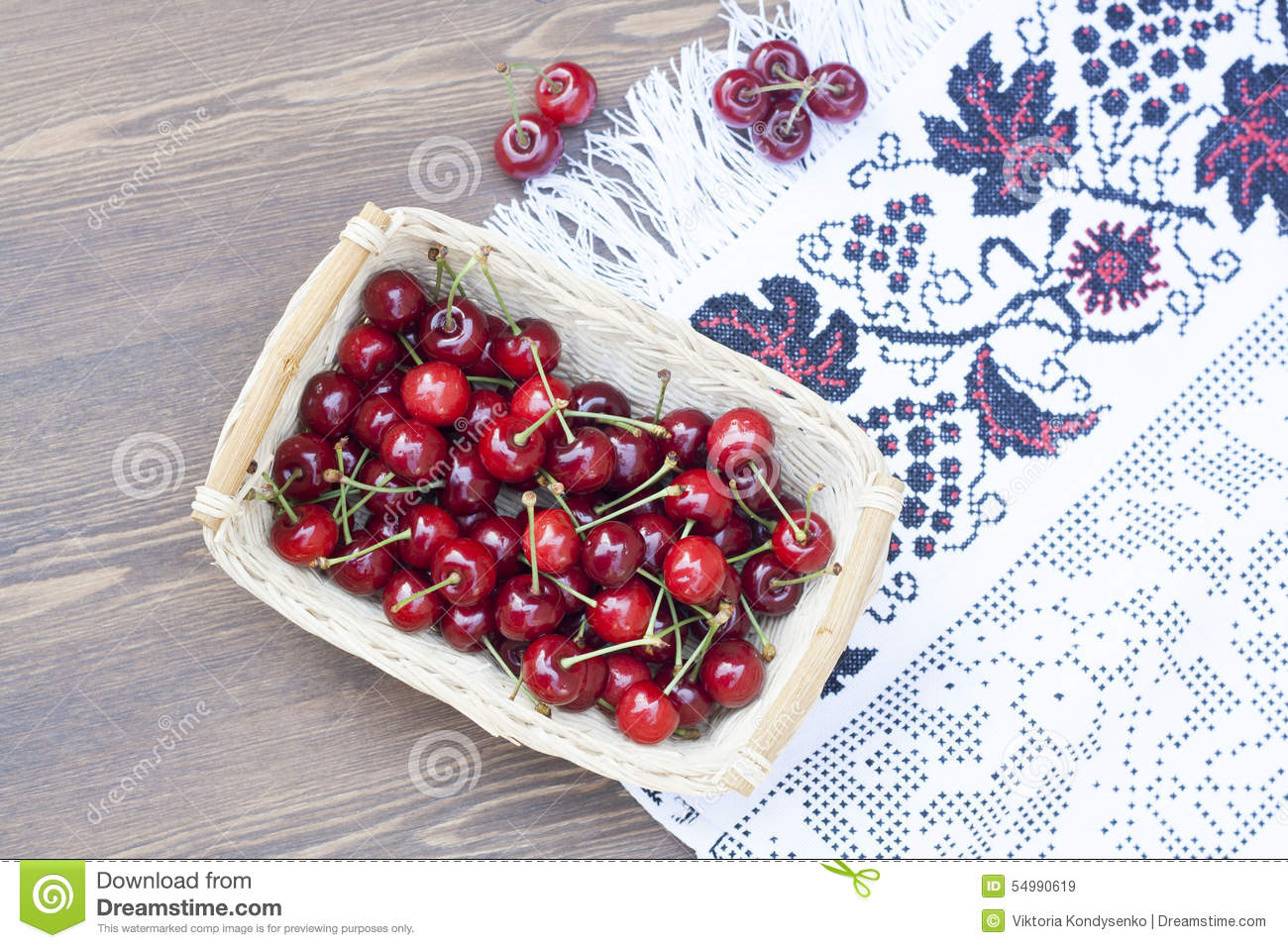 Fresh cherries on embroidered towel