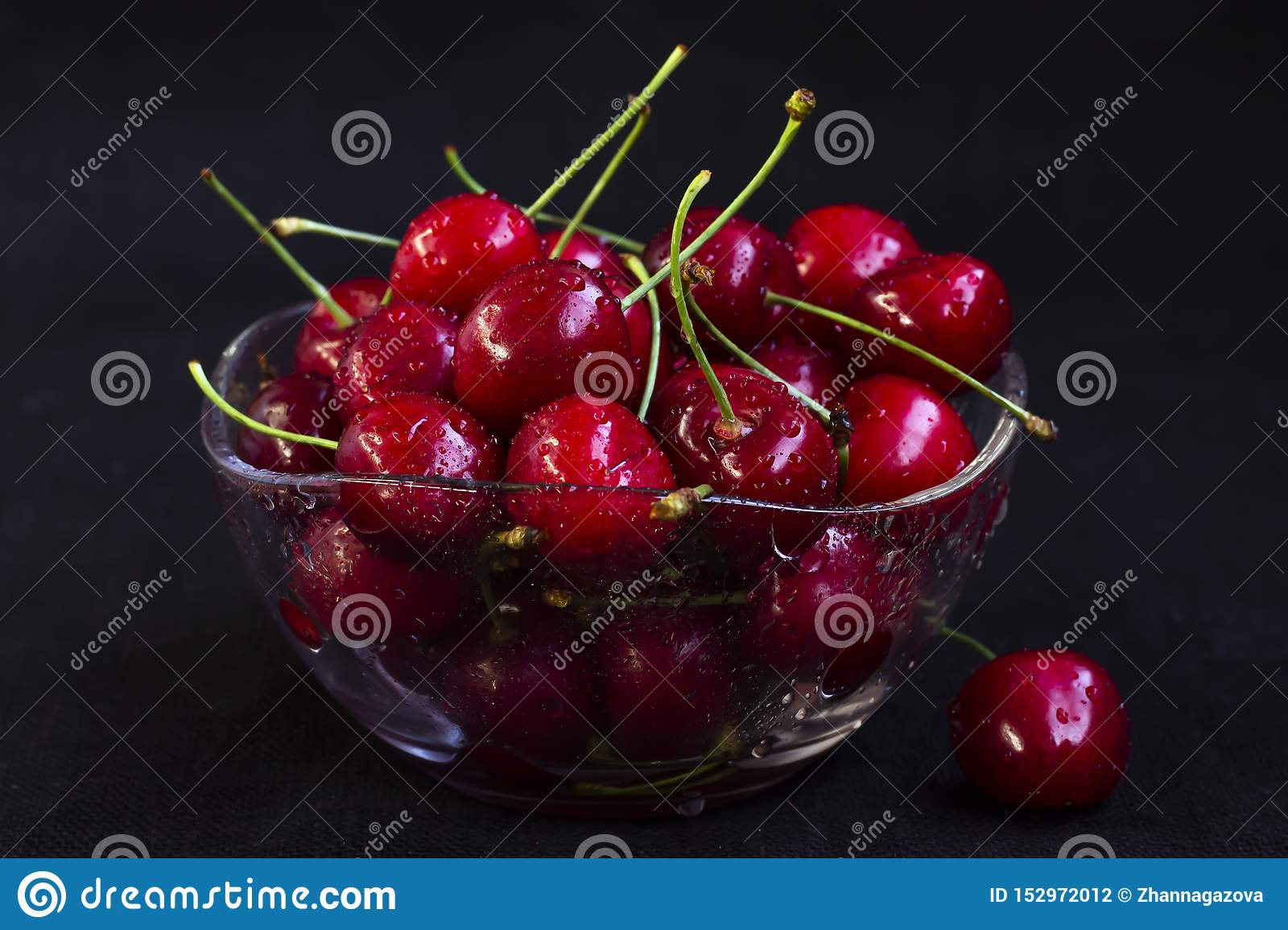 Fresh cherry in a glass plate