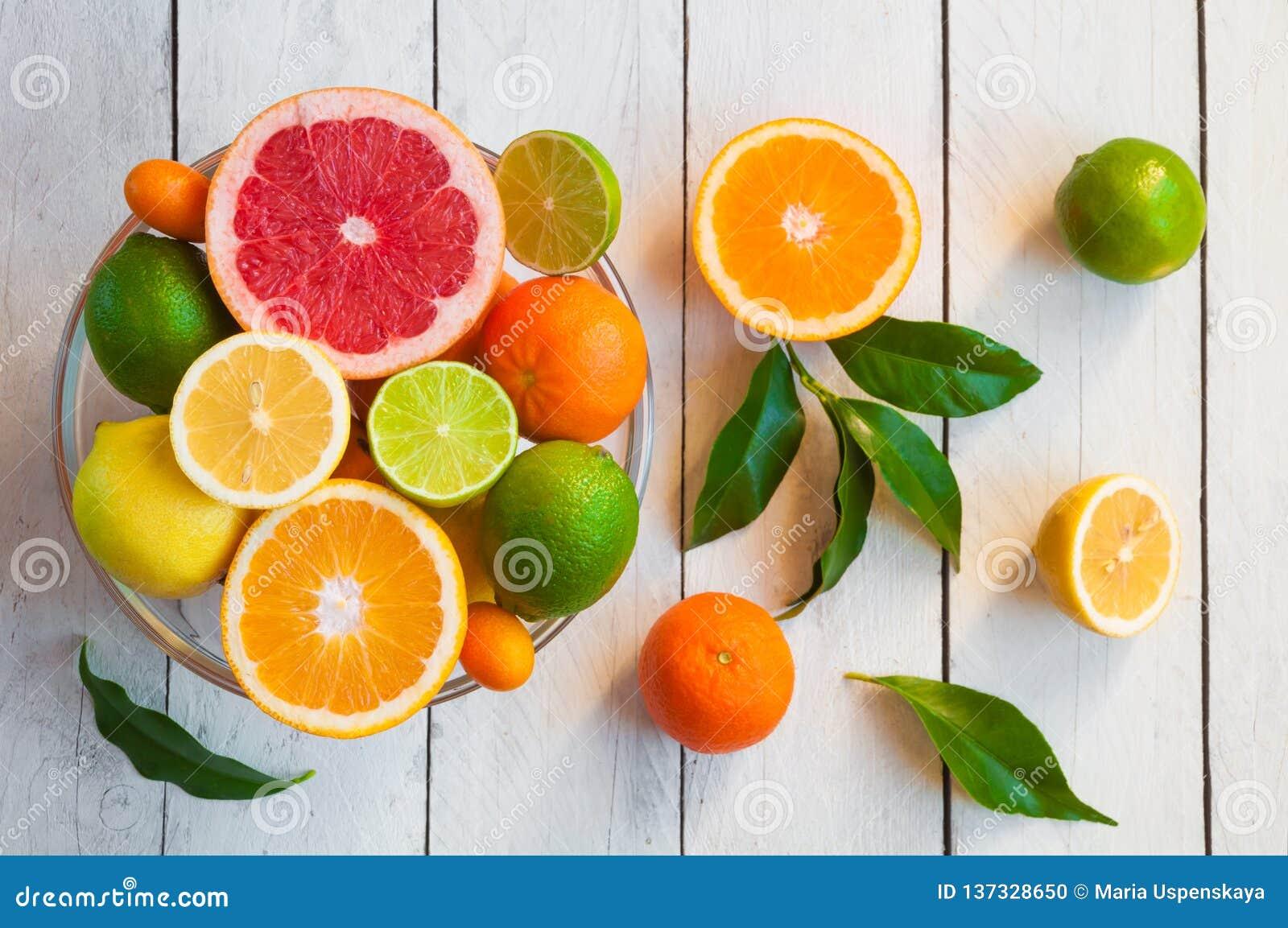 Fresh citrus fruits orange, lemon, grapefruit, mandarin, lime with leaves