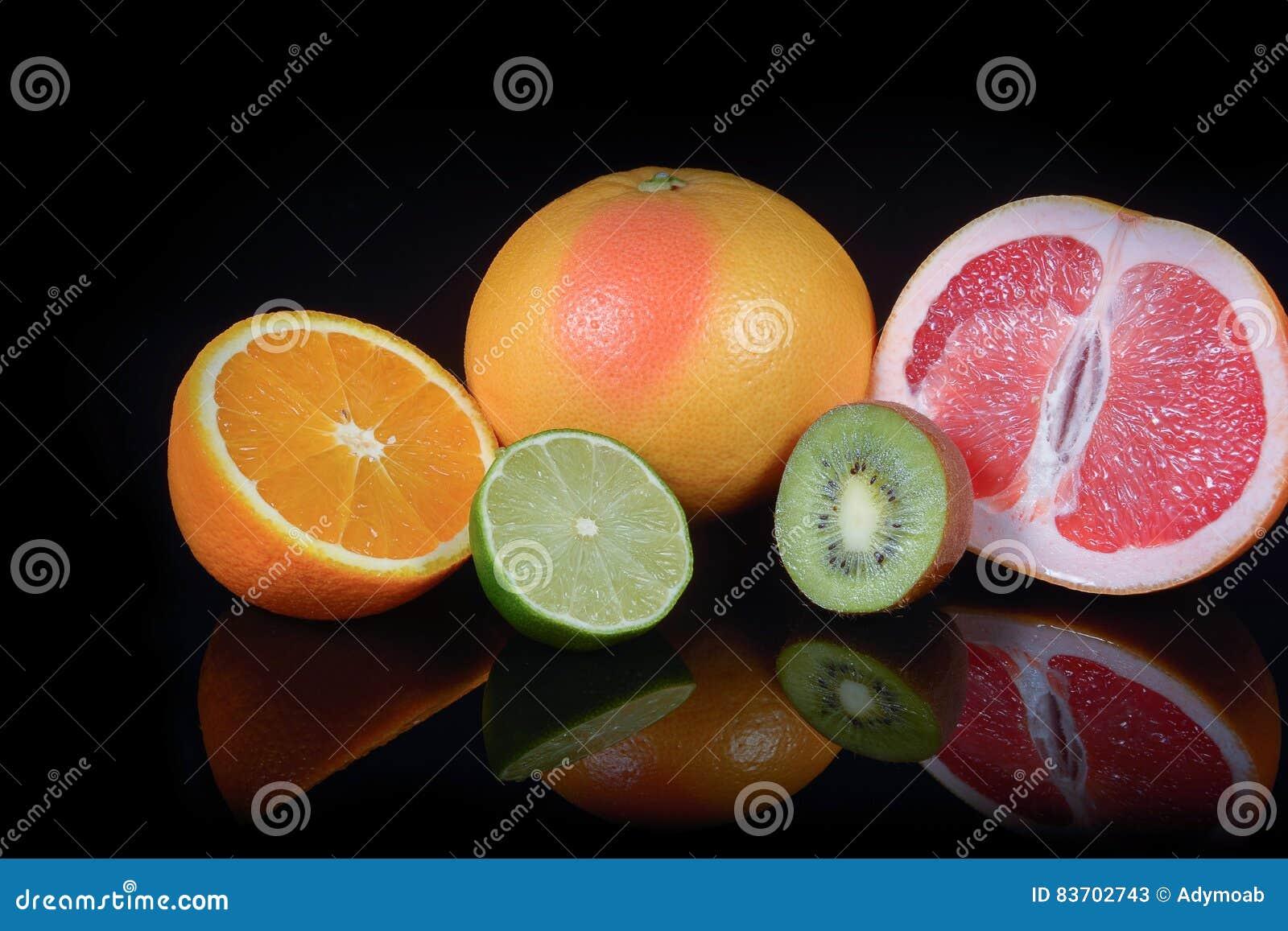 Fresh Citrus Isolated On Black Background Stock Photo