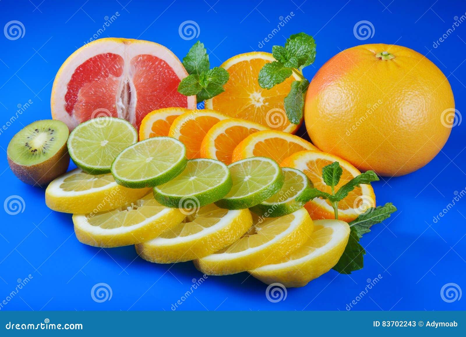 Fresh Citrus Isolated On Blue Background Stock Photo