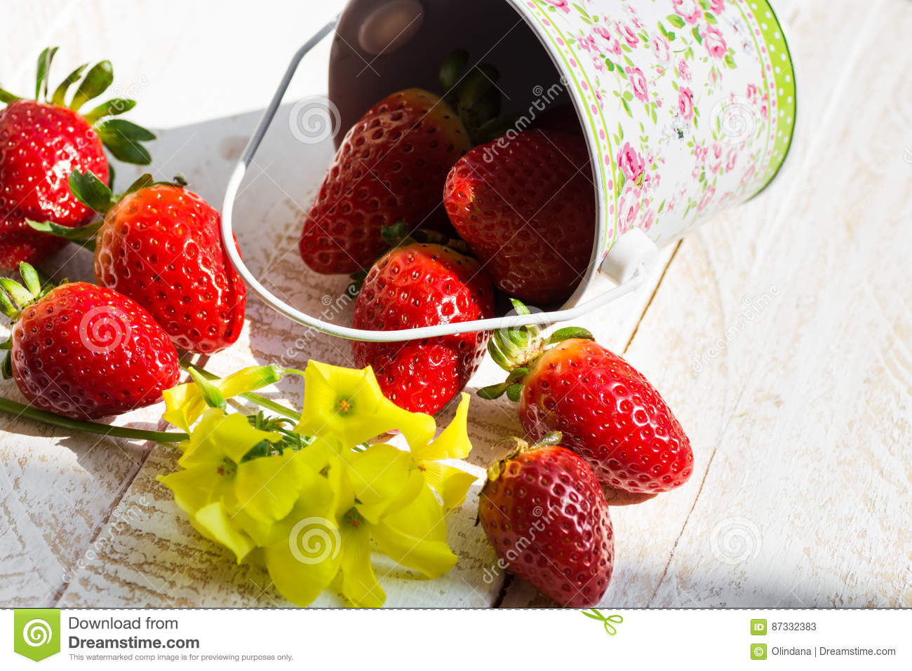 Fresh Colorful Strawberries Spilled From Bucket On Garden Table