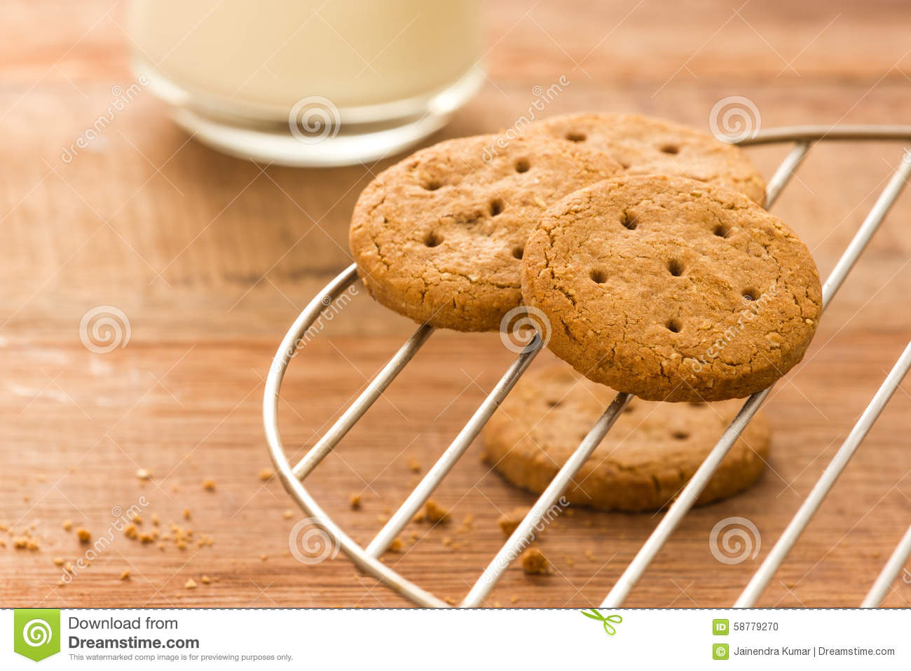 fresh cookies with milk on a wood background