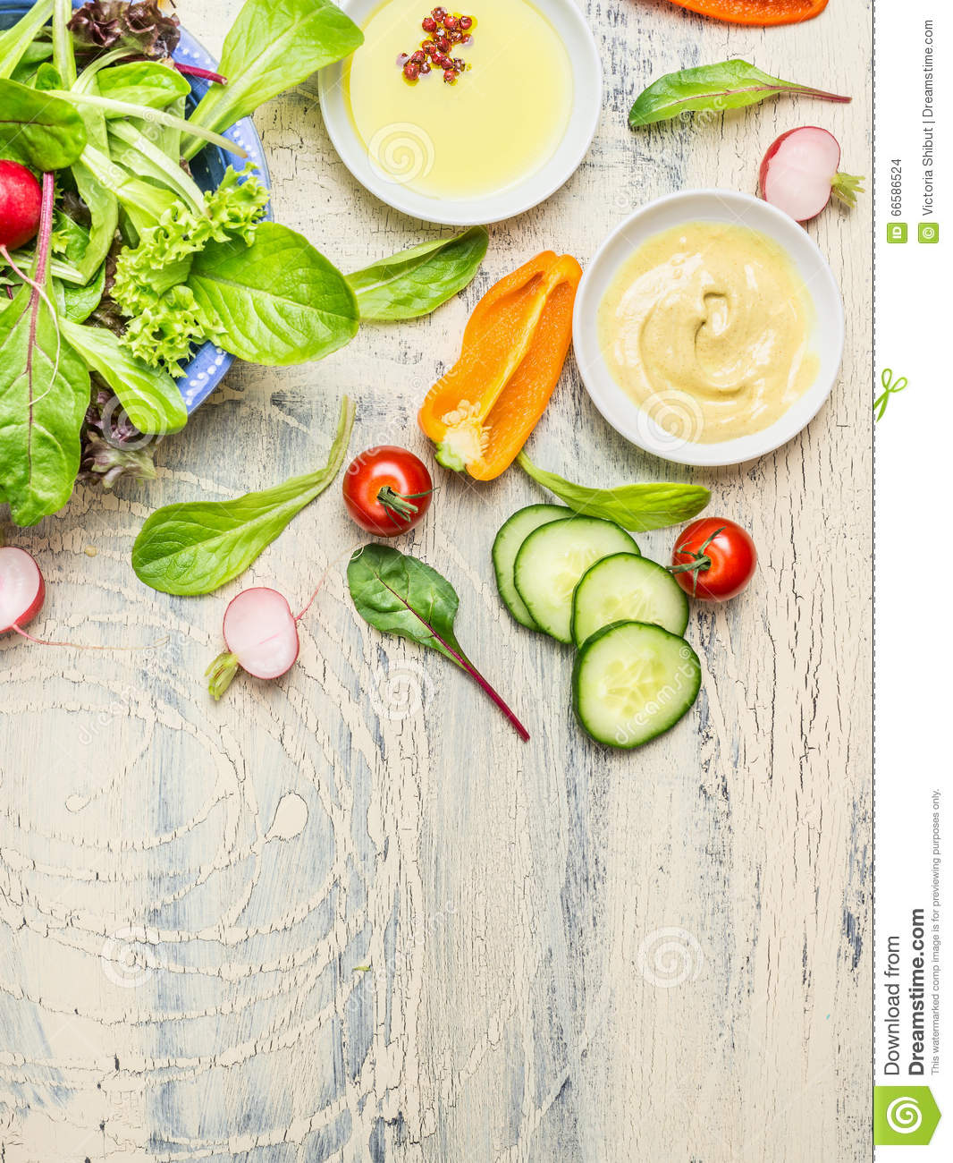Fresh country salad preparation with organic garden vegetables on light rustic kitchen table, top view, place for text.