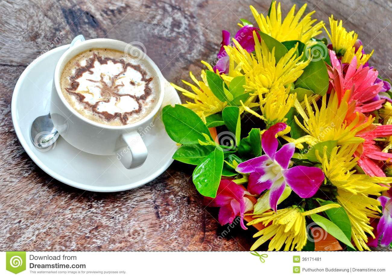Fresh cup of coffee with flowers stock image image of breakfast fresh cup of coffee with flowers izmirmasajfo Choice Image