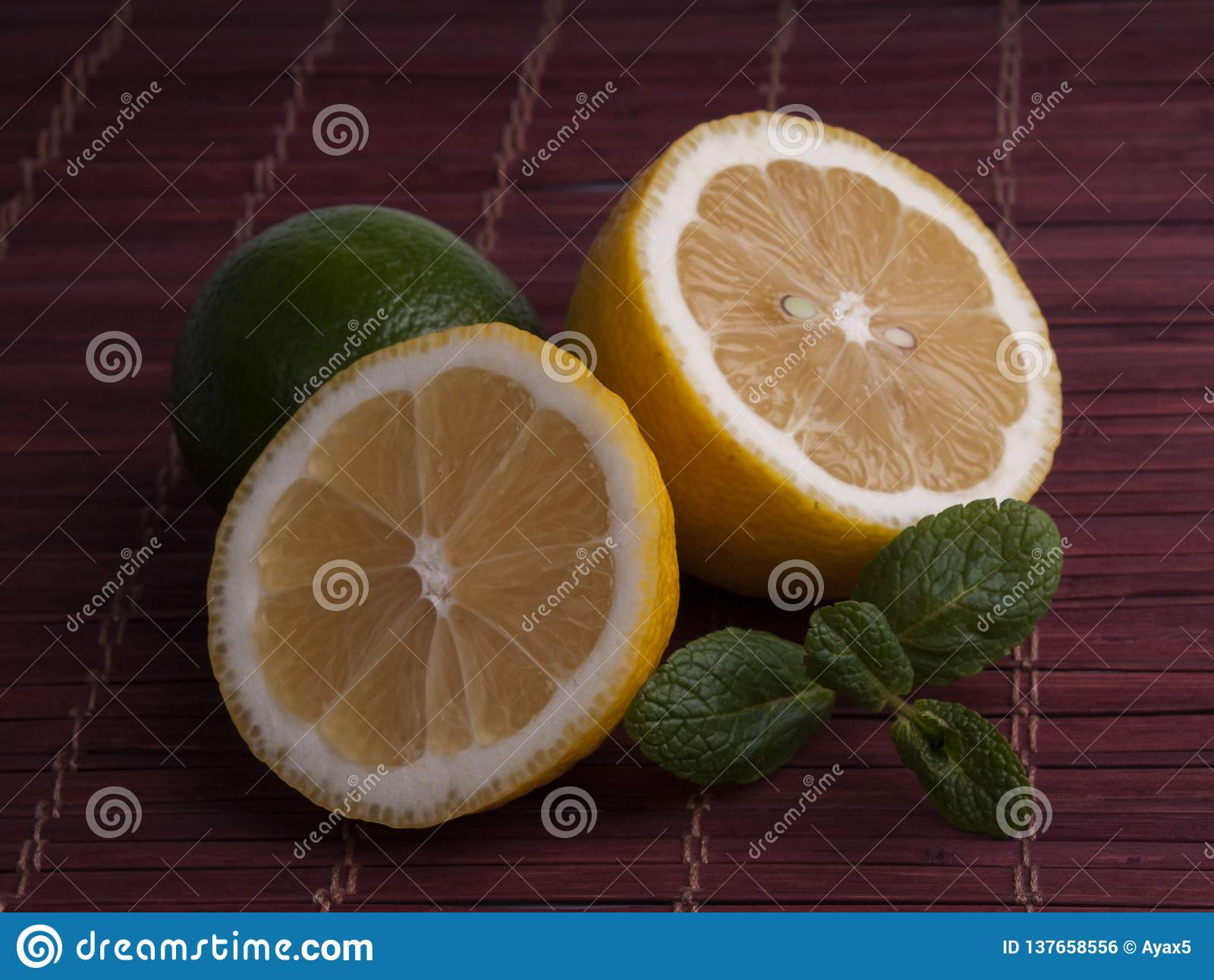 Fresh cut lemon and lime with mint