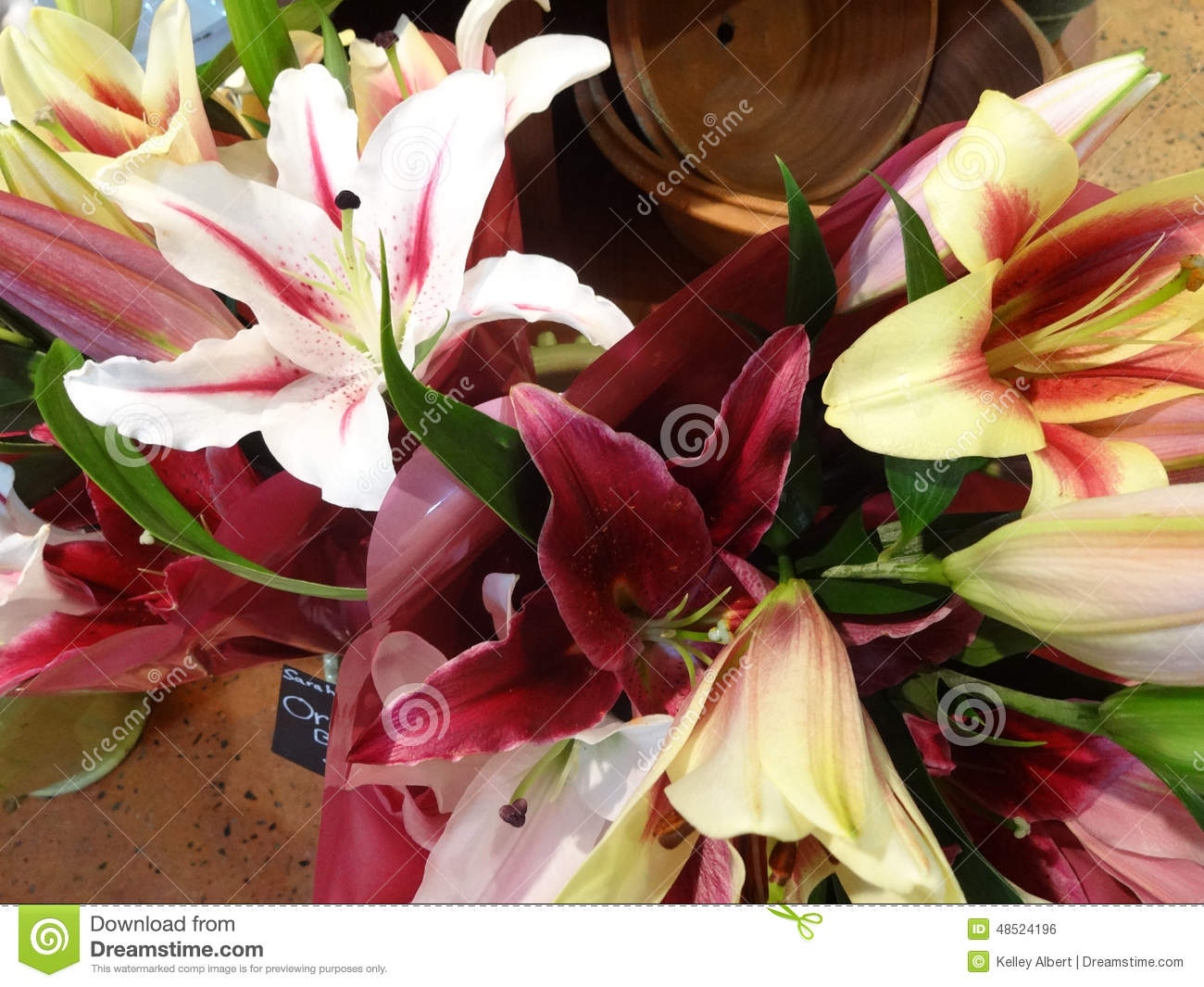 Fresh cut lily flowers for sale inside a floral shop stock photo royalty free stock photo izmirmasajfo Image collections