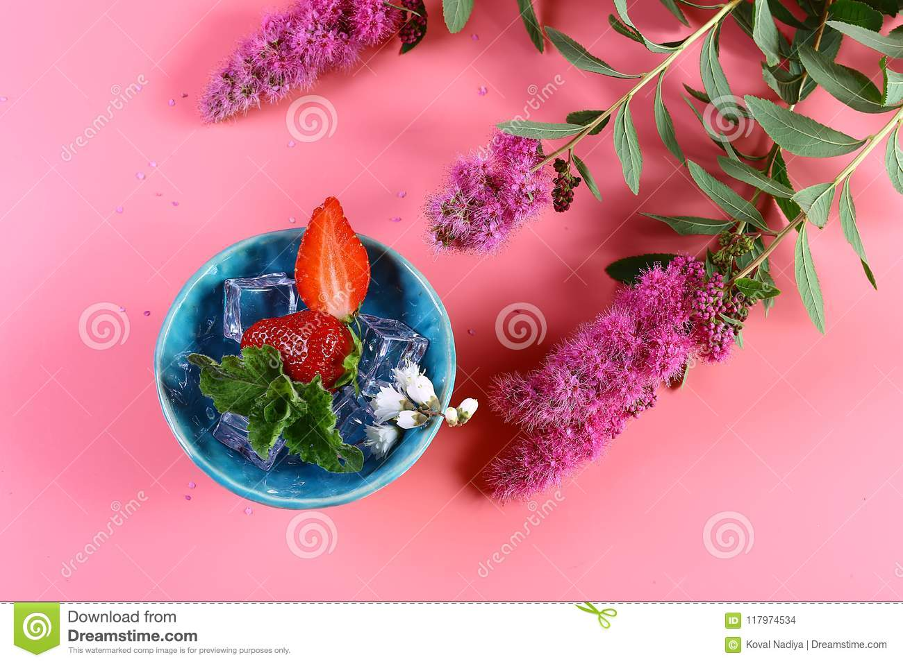 Fresh cut strawberries in a blue plate with ice mint pink flowers download comp mightylinksfo