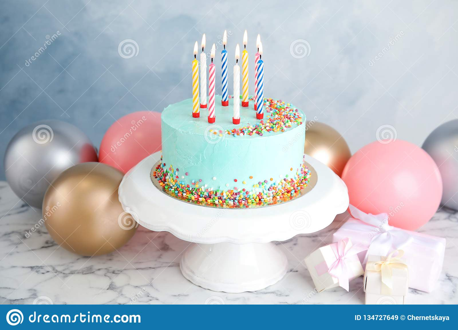 Fresh Delicious Birthday Cake, Gifts And Balloons On Table ...