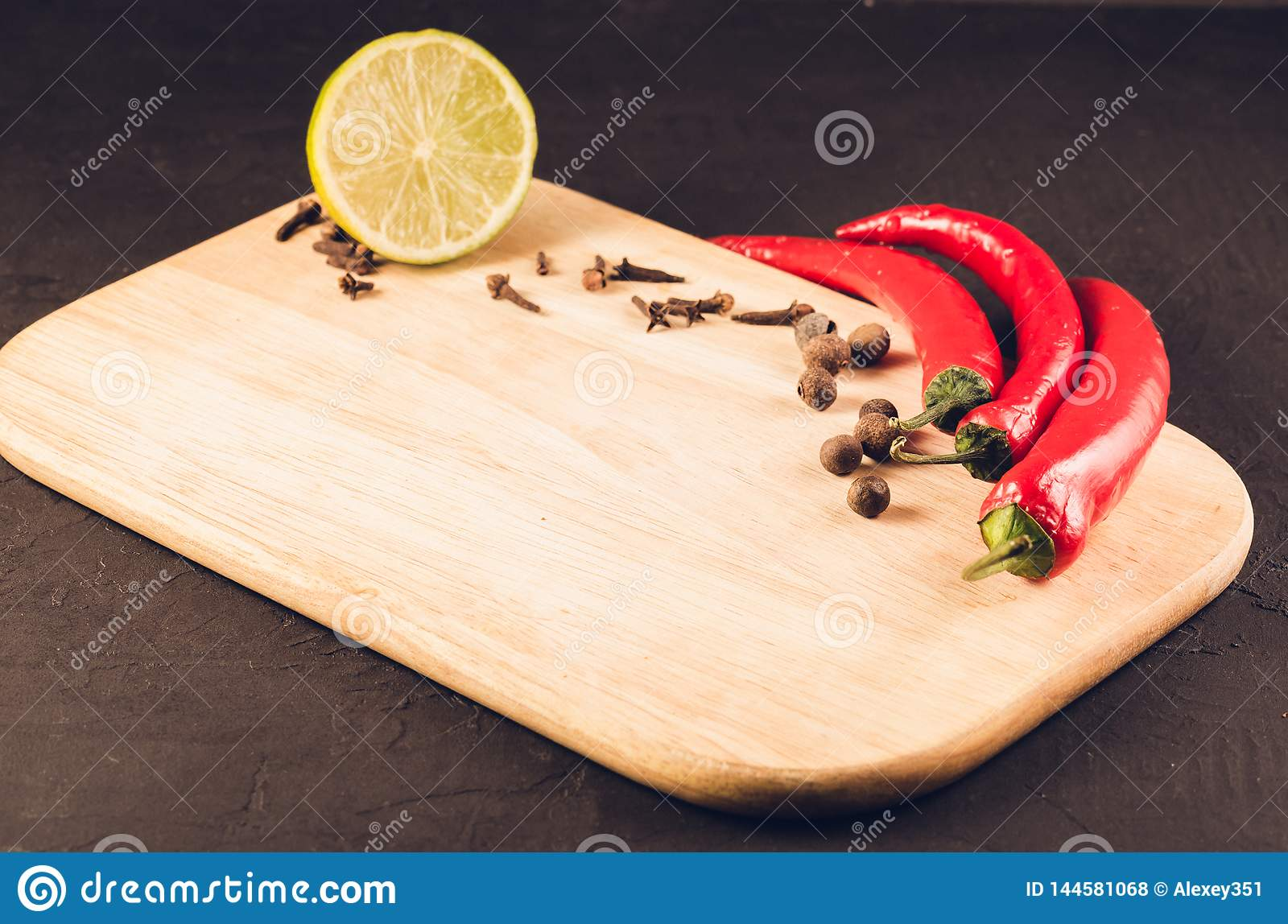 Fresh delicious ingredients and empty cutting board/Fresh delicious ingredients and empty cutting board on a dark background