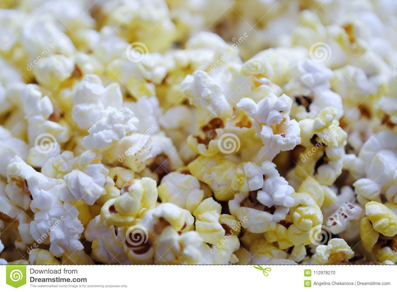 Fresh delicious popcorn with cheese close up