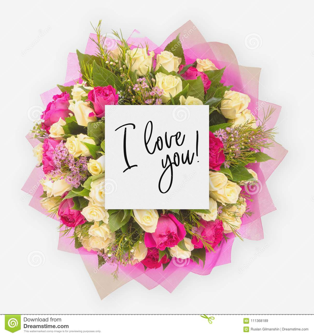 fresh flowers bunch and card with words i love you written