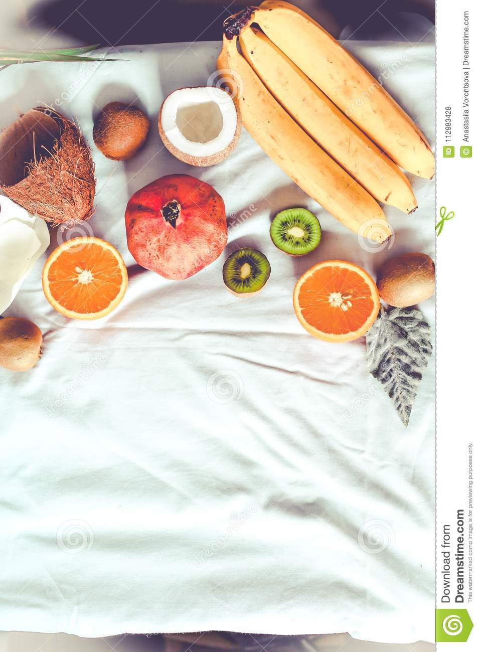 Fresh fruit background. Healthy eating and dieting concept. Winter assortment. Top view. Tone.