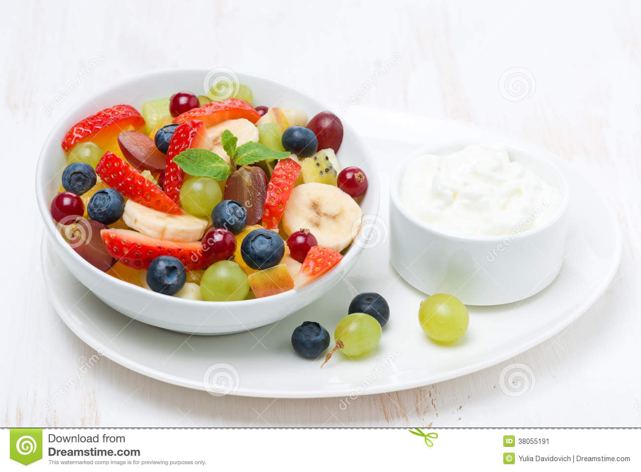 Fresh fruit and berry salad and cream