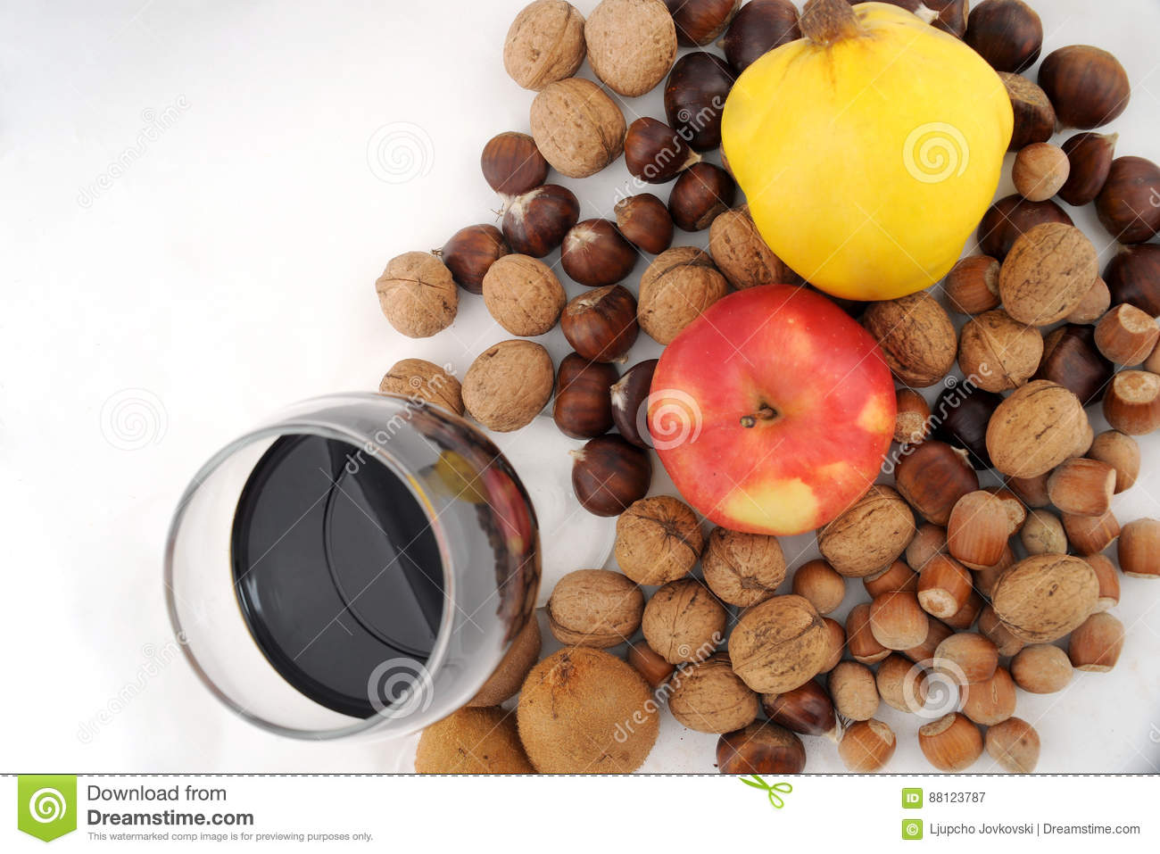 Fresh fruit combined with nuts and glass of wine