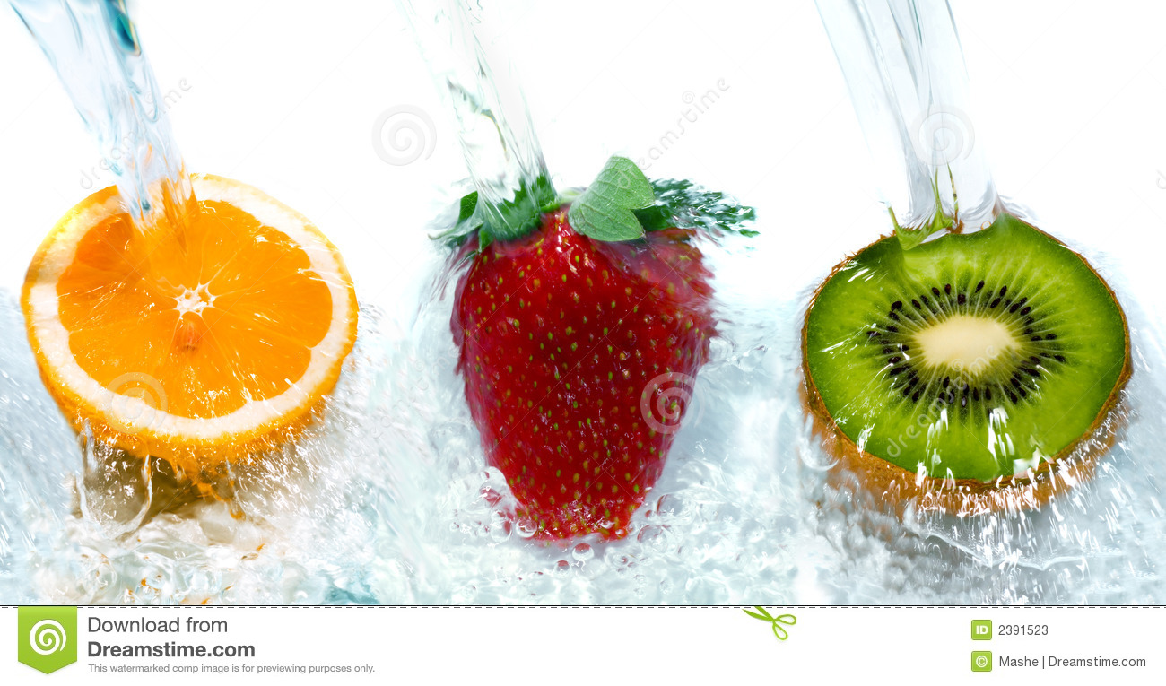 Fresh fruit jumping into water