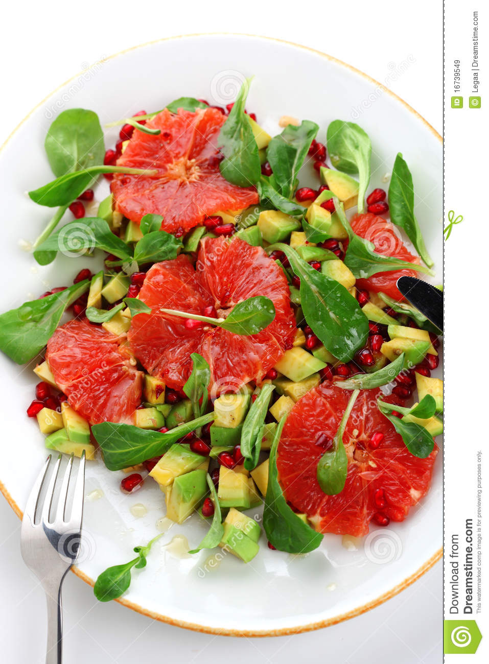 Fresh salad with grapefruit, avocado and pomegranate seeds.