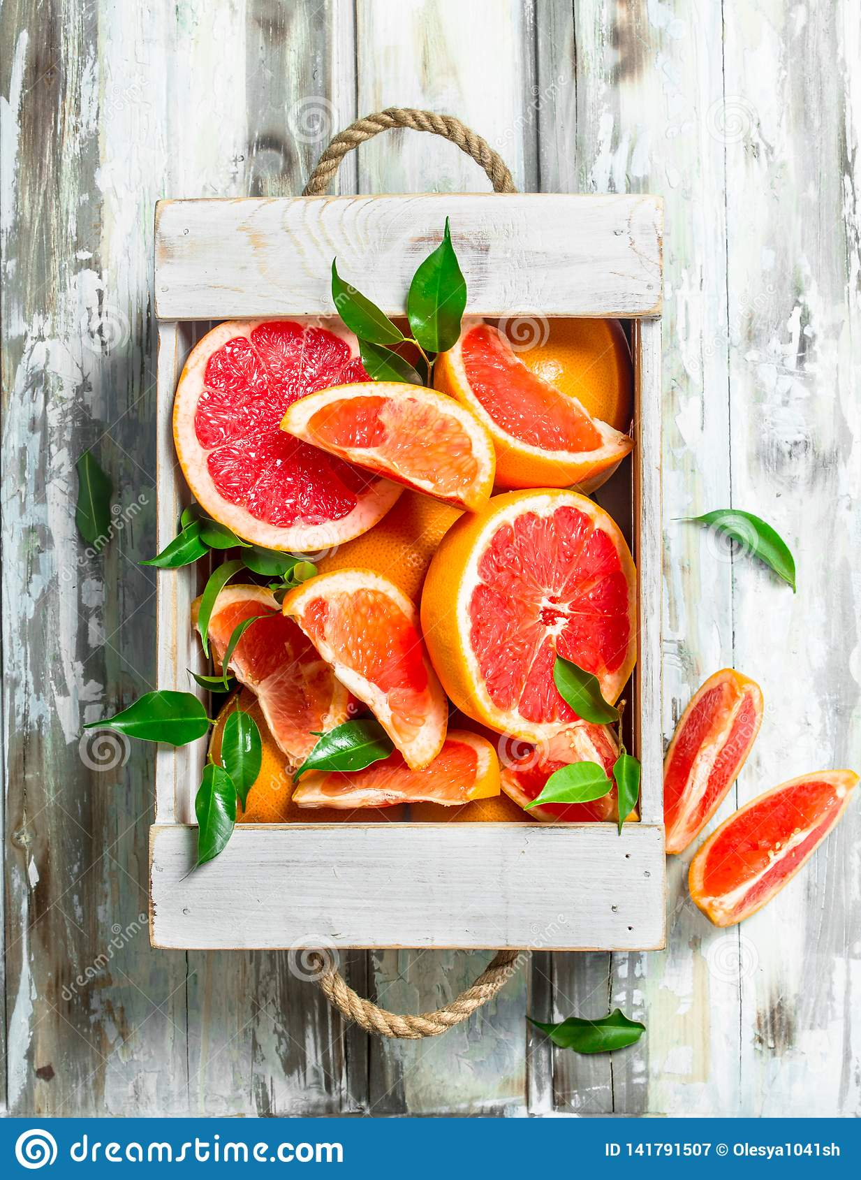 Fresh grapefruit in wooden box