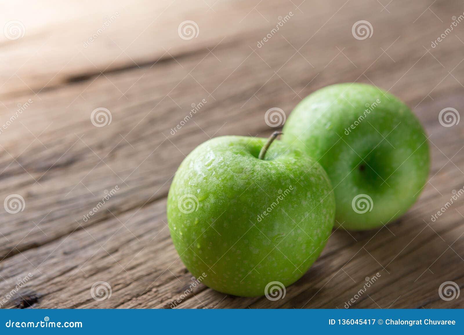 Fresh Green Apple on Wood