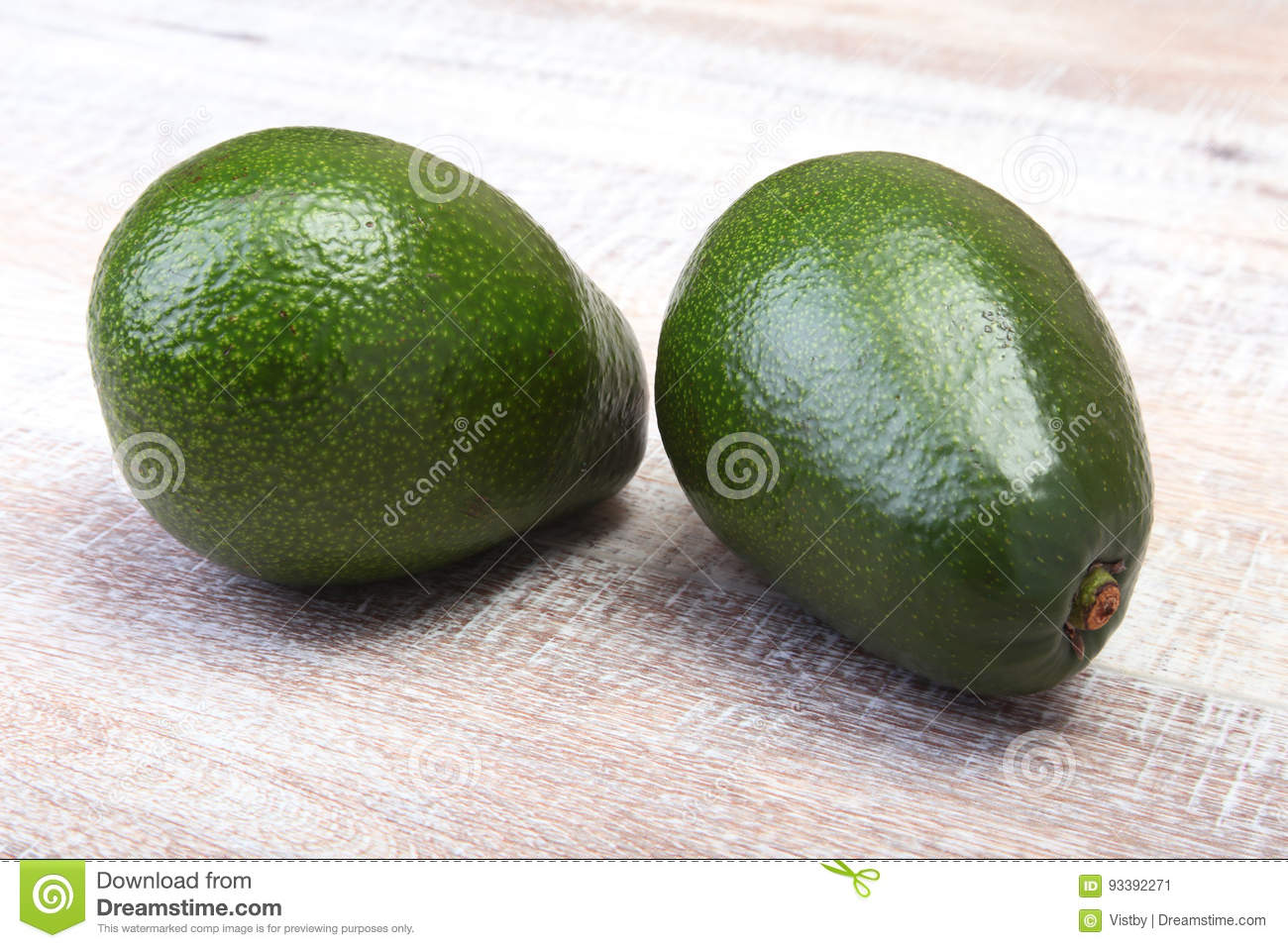 Fresh, green Avocado isolated on a white background.