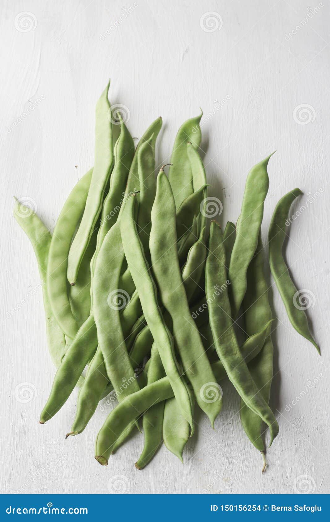 Fresh green bean vegetable on a white background