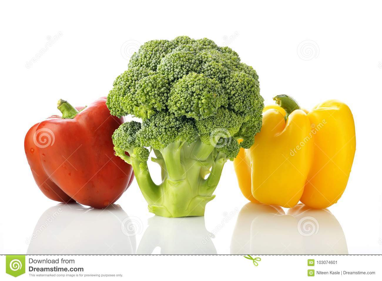 Fresh Green Broccoli With Red And Yellow Bell Pepper On White
