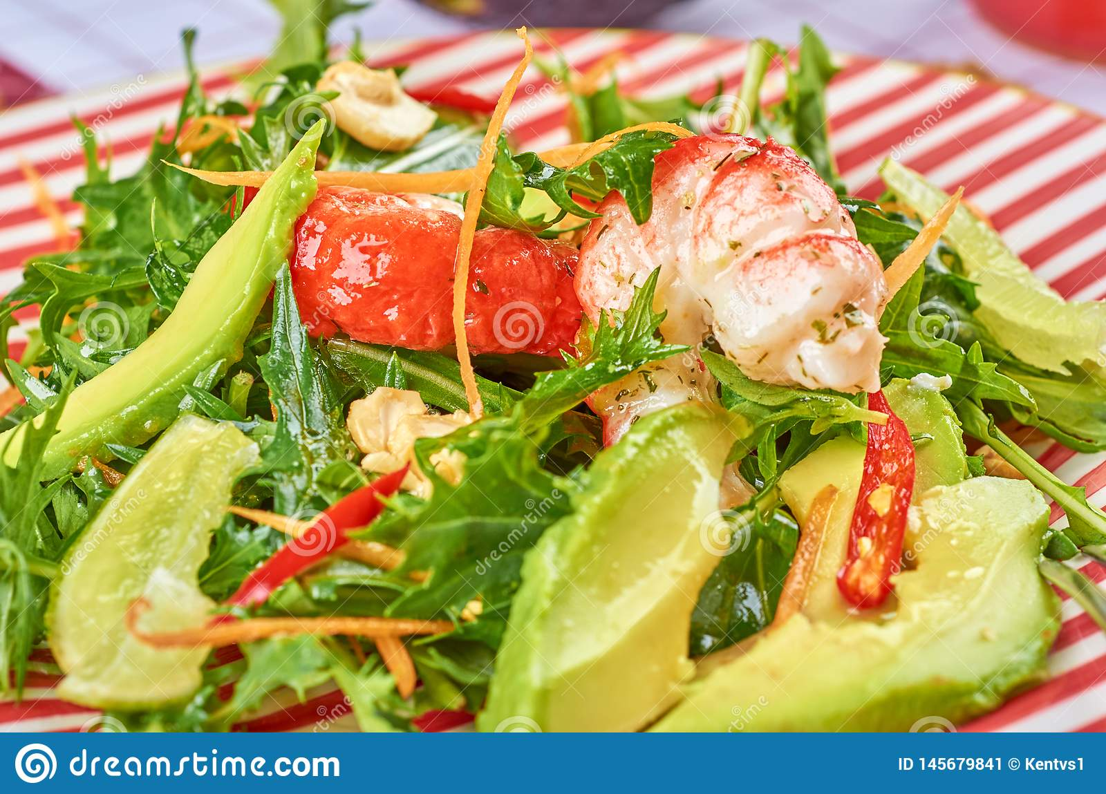 Fresh green salad with shrimps and poached egg