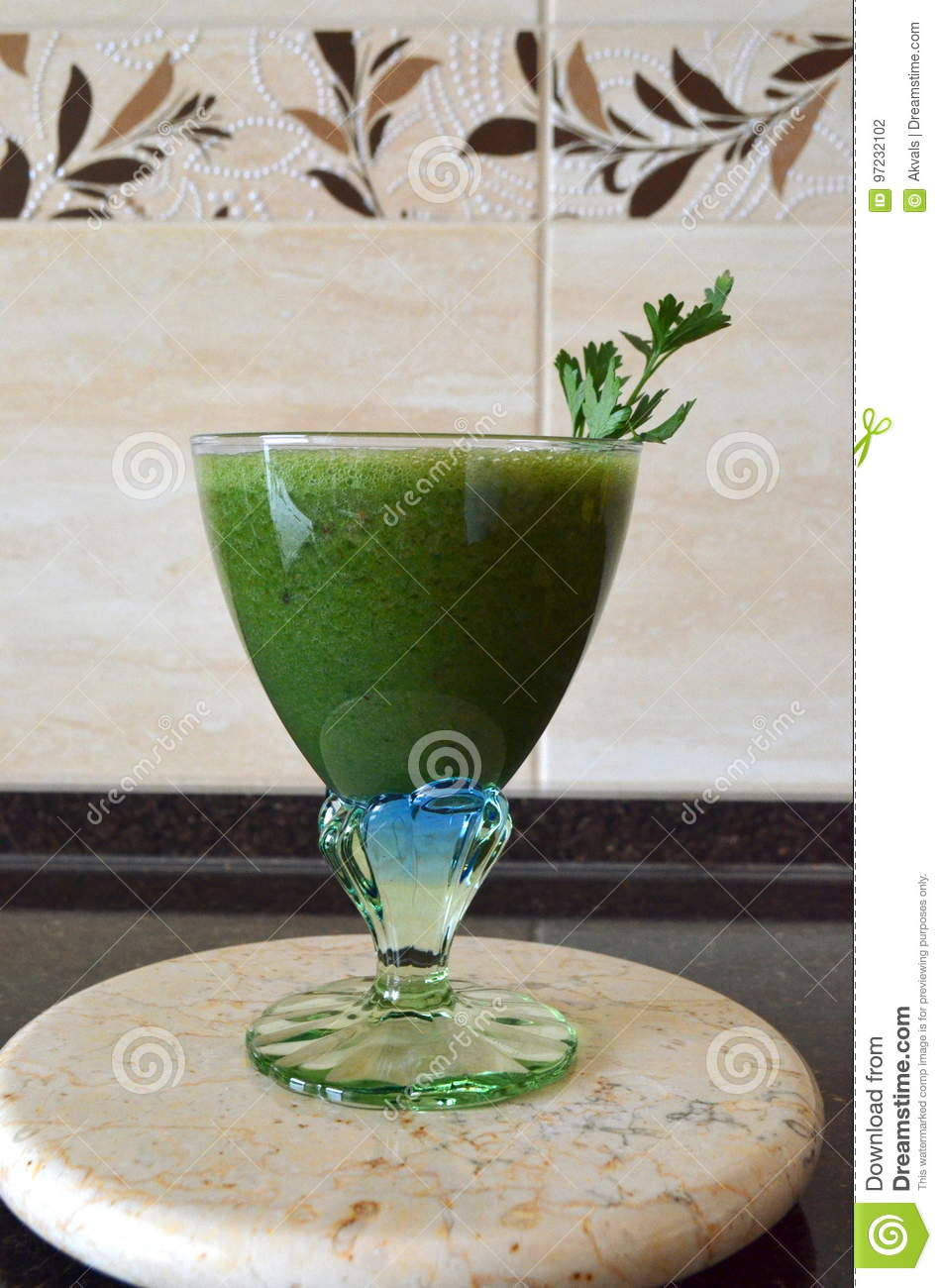 Fresh Green Smoothie In A Wide Glass On Stem On The Kitchen