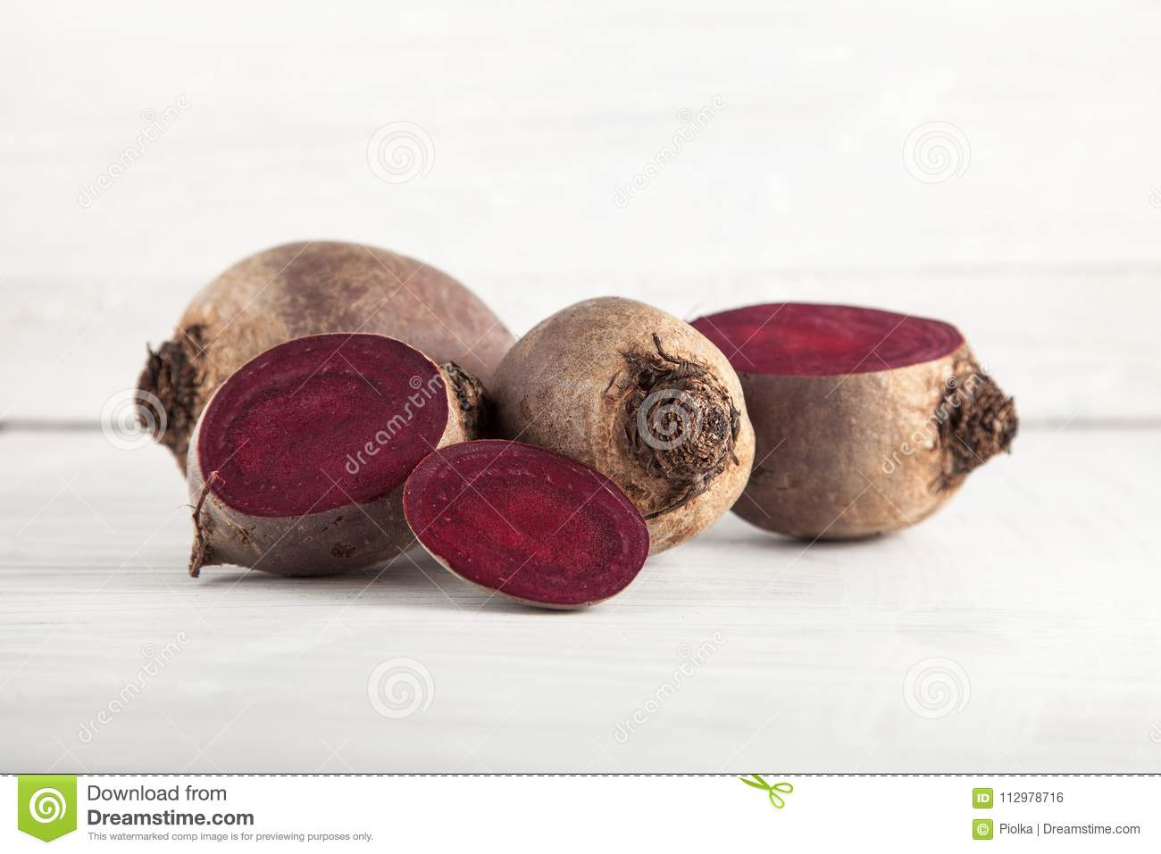 Fresh harvested beetroot on white wooden kitchen plate
