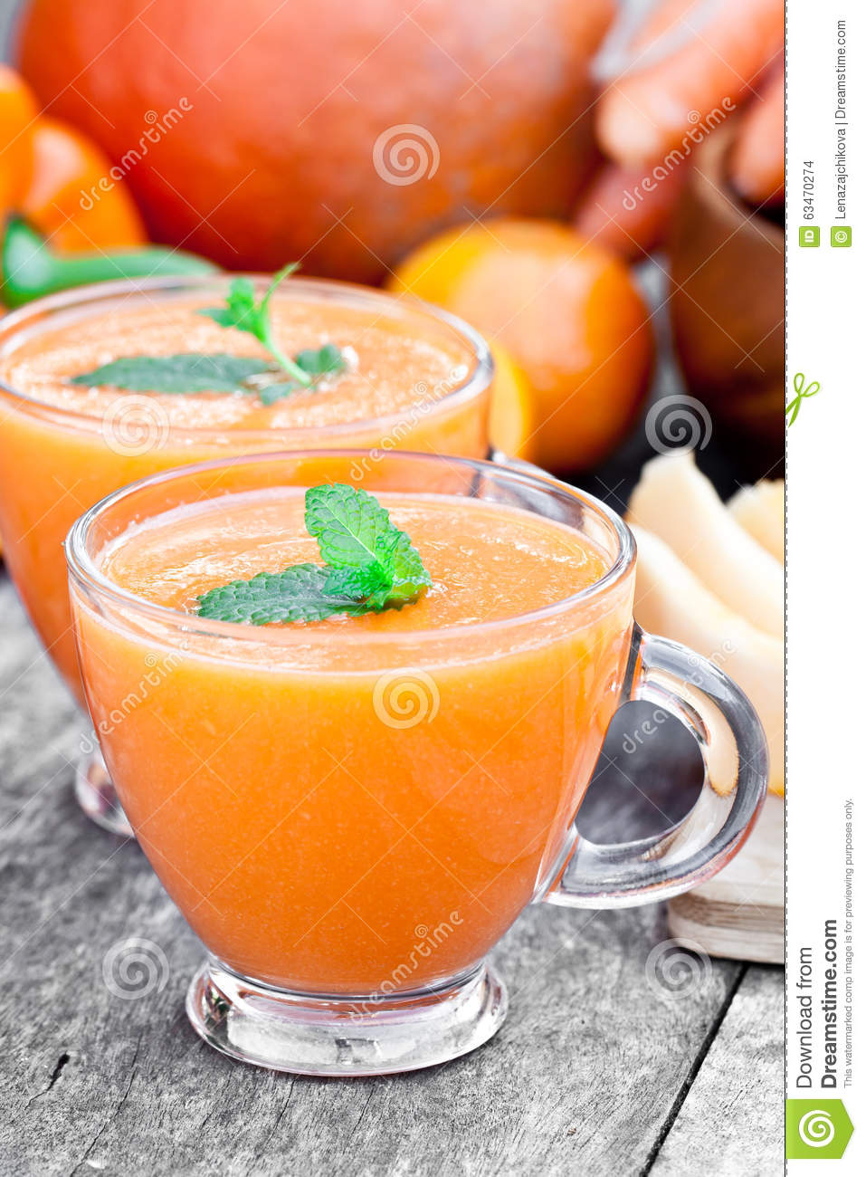 Fresh healthy pulpy cocktail with orange fruits and berries and