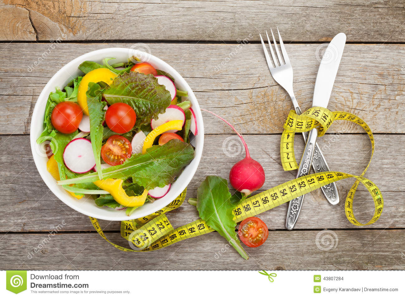 Fresh healthy salad and measuring tape healthy food stock for Cuisine wooden