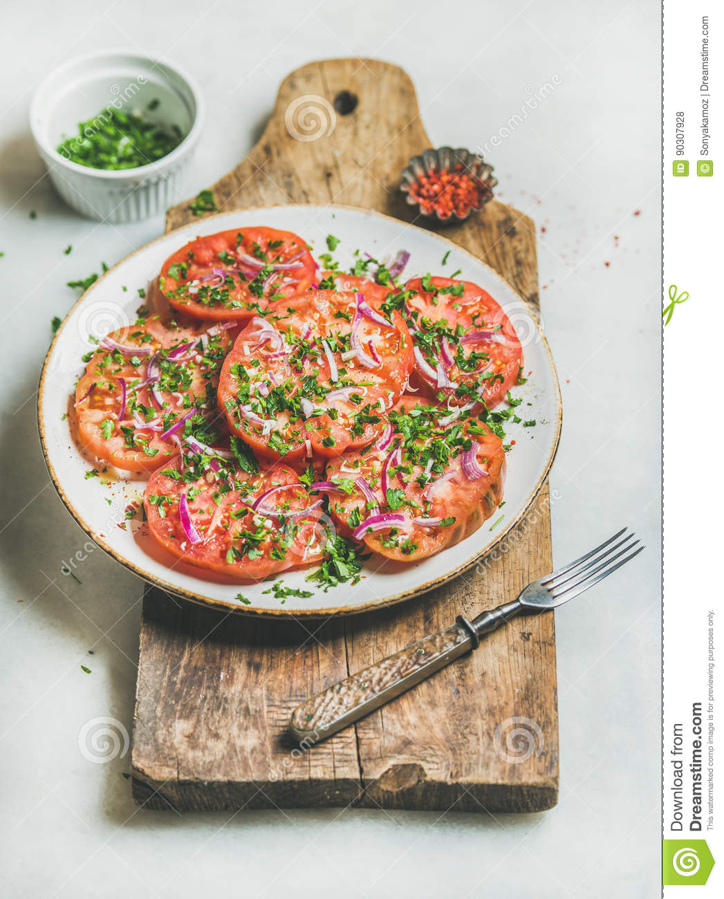 Fresh heirloom tomato, parsley and onion salad. Clean eating food