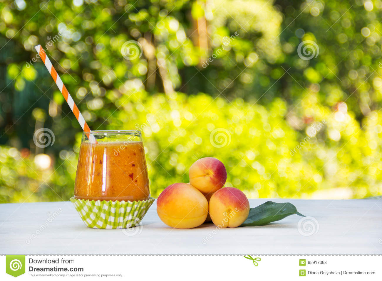 Fresh homemade apricot smoothies in the summer garden. Summer detox drinks. Refreshing drink from apricots and peaches.