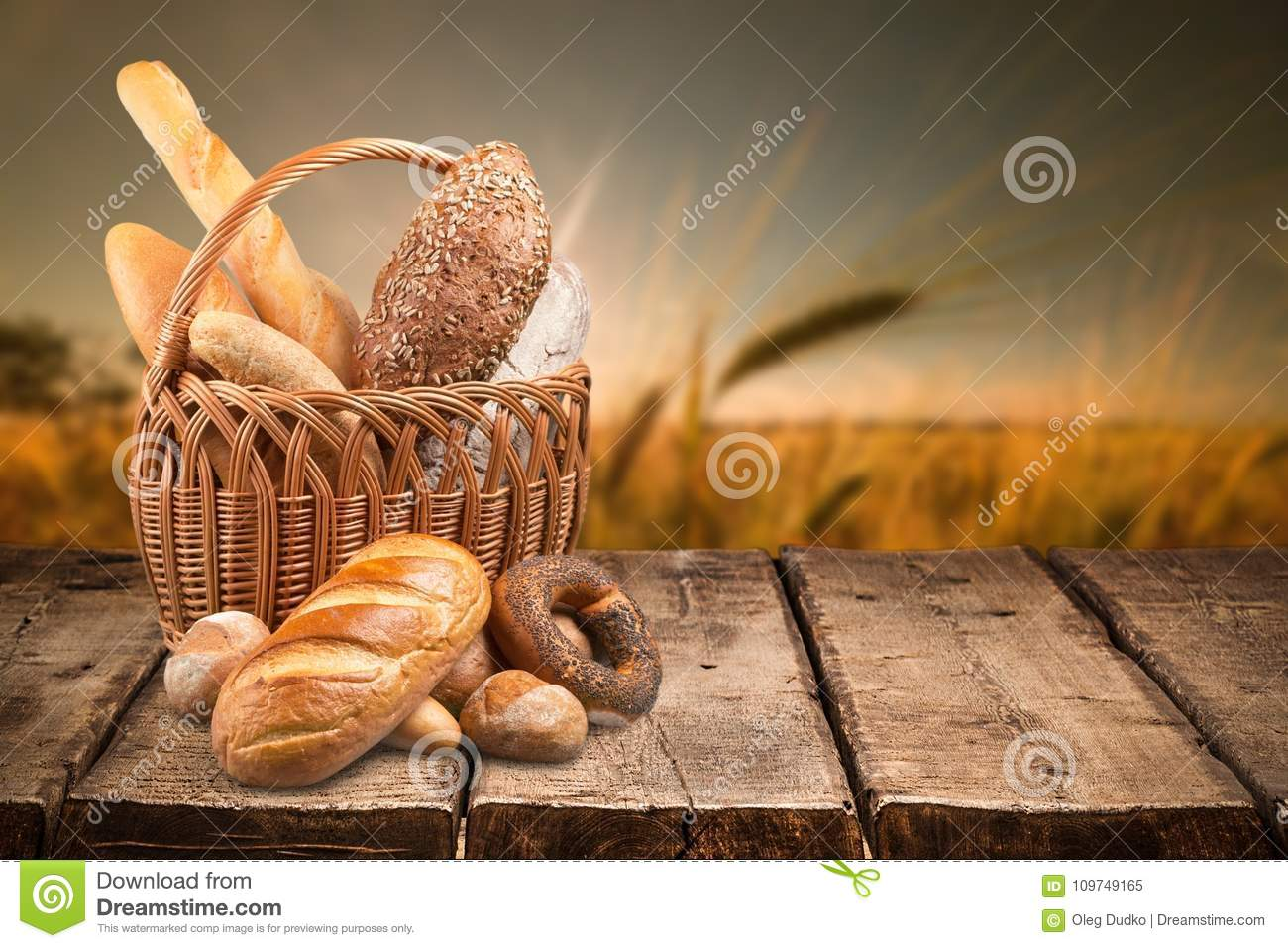 Fresh homemade bread loaves in basket on nature