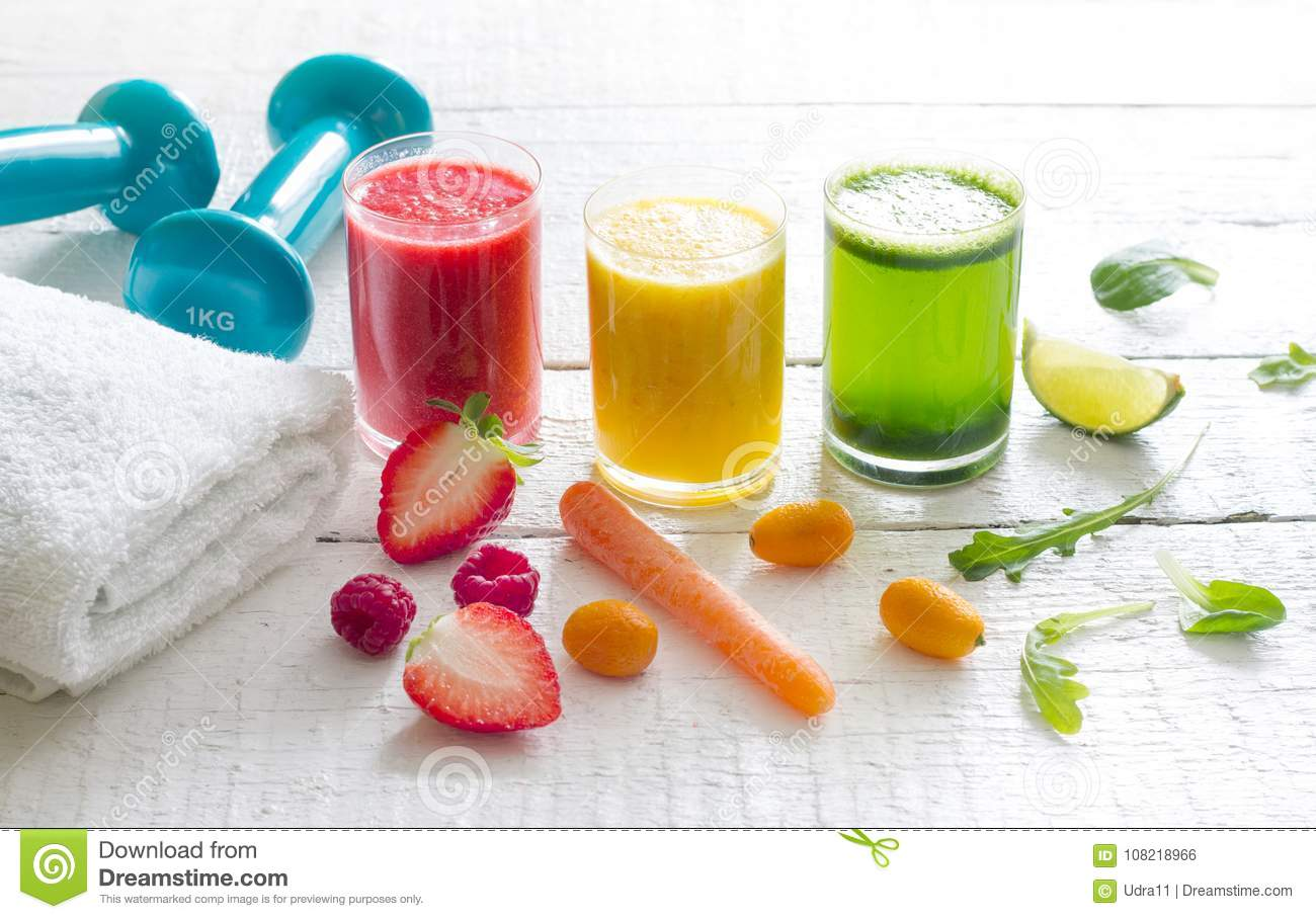 Fresh juices and gym equipment sport fitness healthy diet lifestyle concept