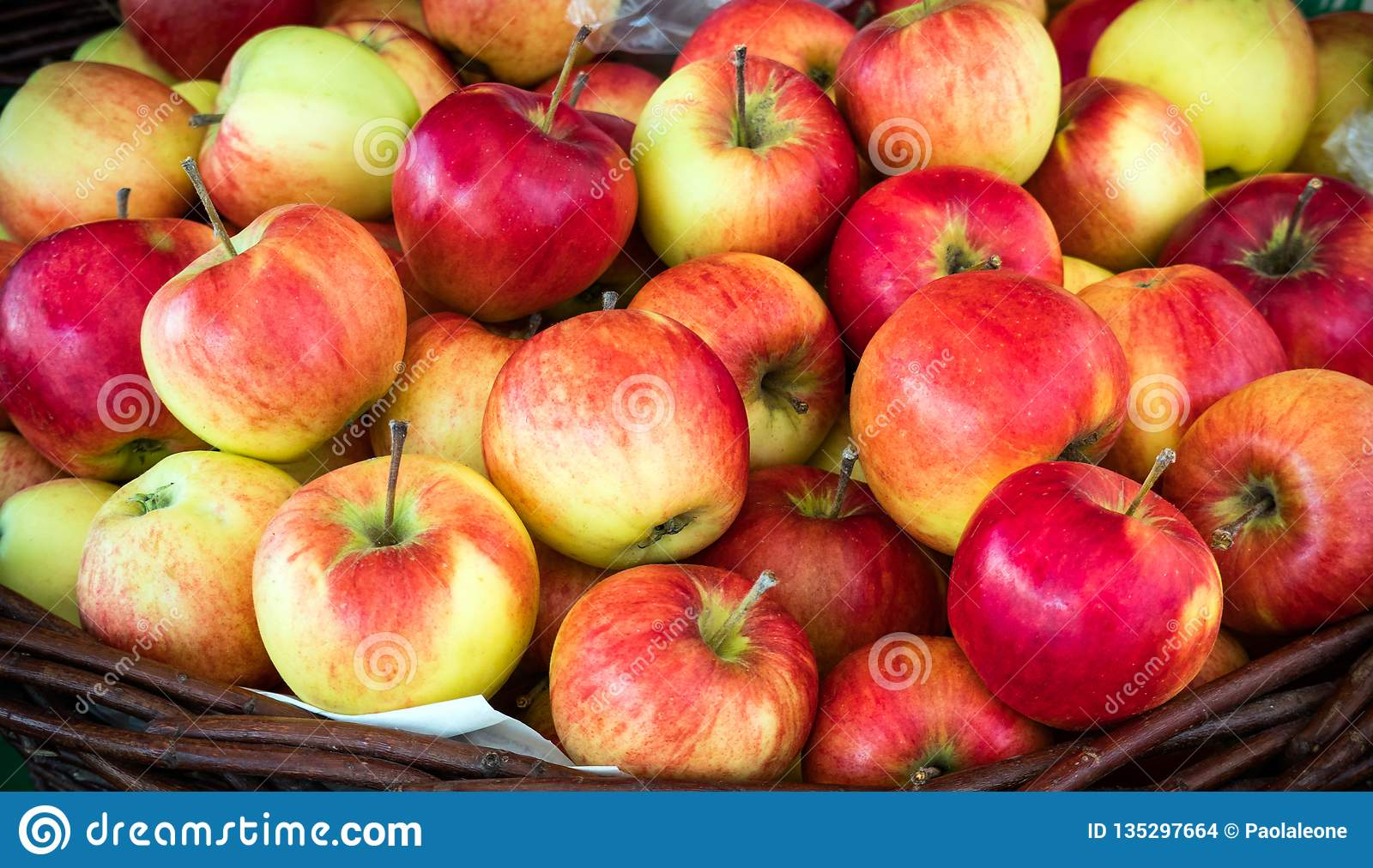 Fresh Juicy Red Apples Stack in a Basket on sale. Beautiful Natural Background