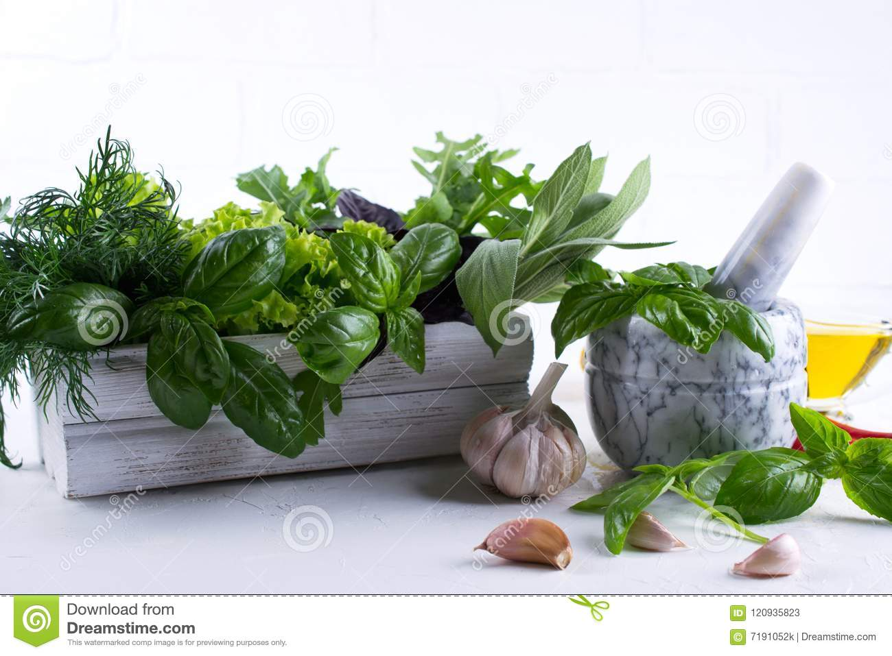 Fresh Kitchen Herbs And Spices Oil With A White Ceramic Mortar