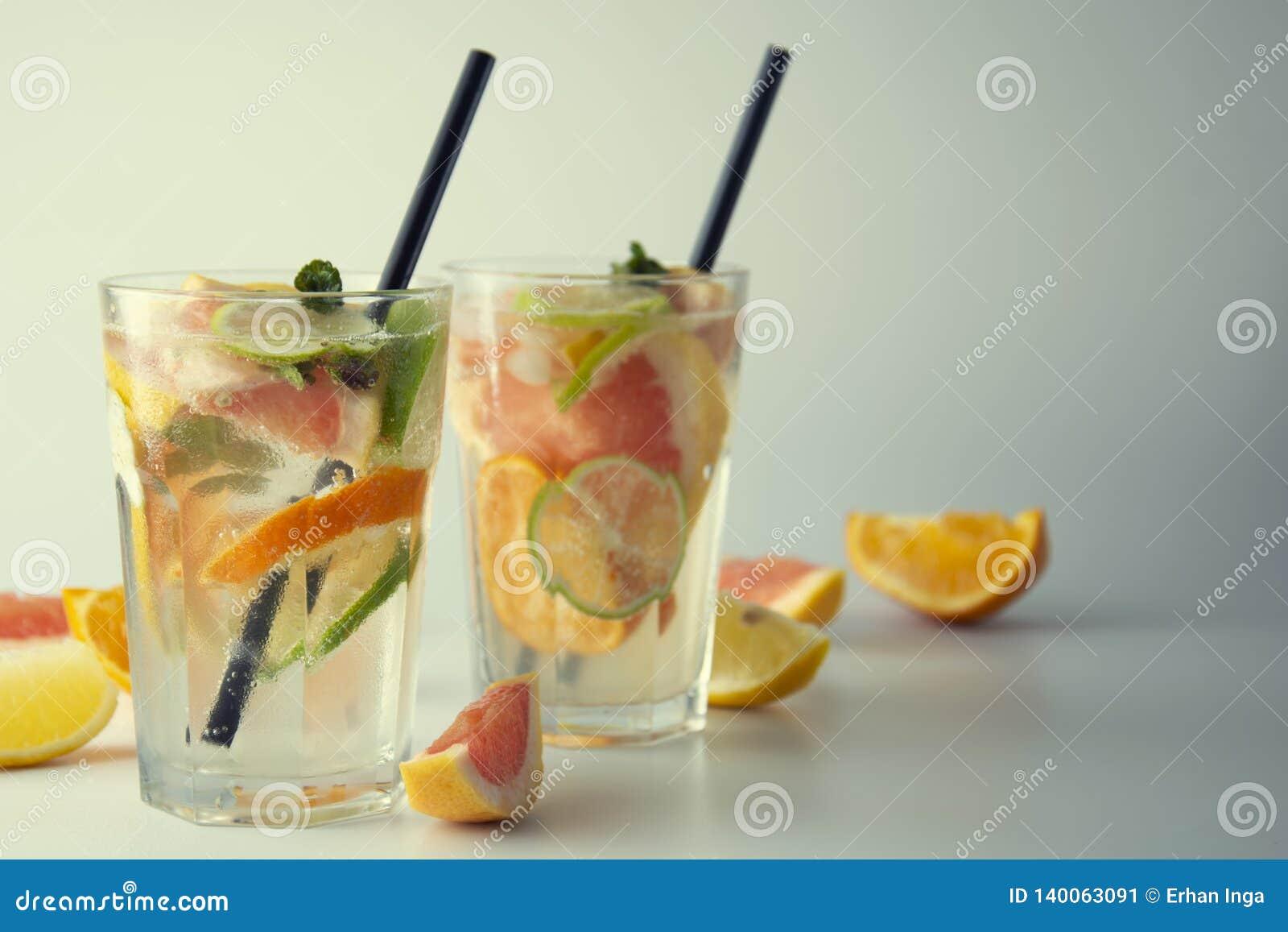 Fresh Lemonade Or Cocktails Refreshing Summer Homemade Cocktail With Lemon Lime Orange And Grapefruit Two Glasses Or Fruit Stock Image Image Of Drink Ingredient 140063091