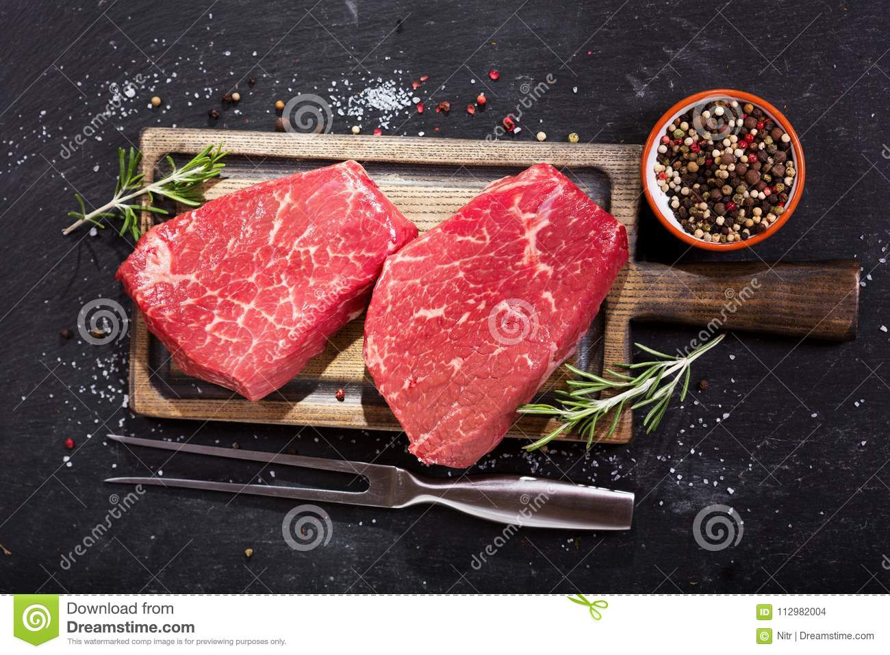 Fresh meat with ingredients for cooking, top view