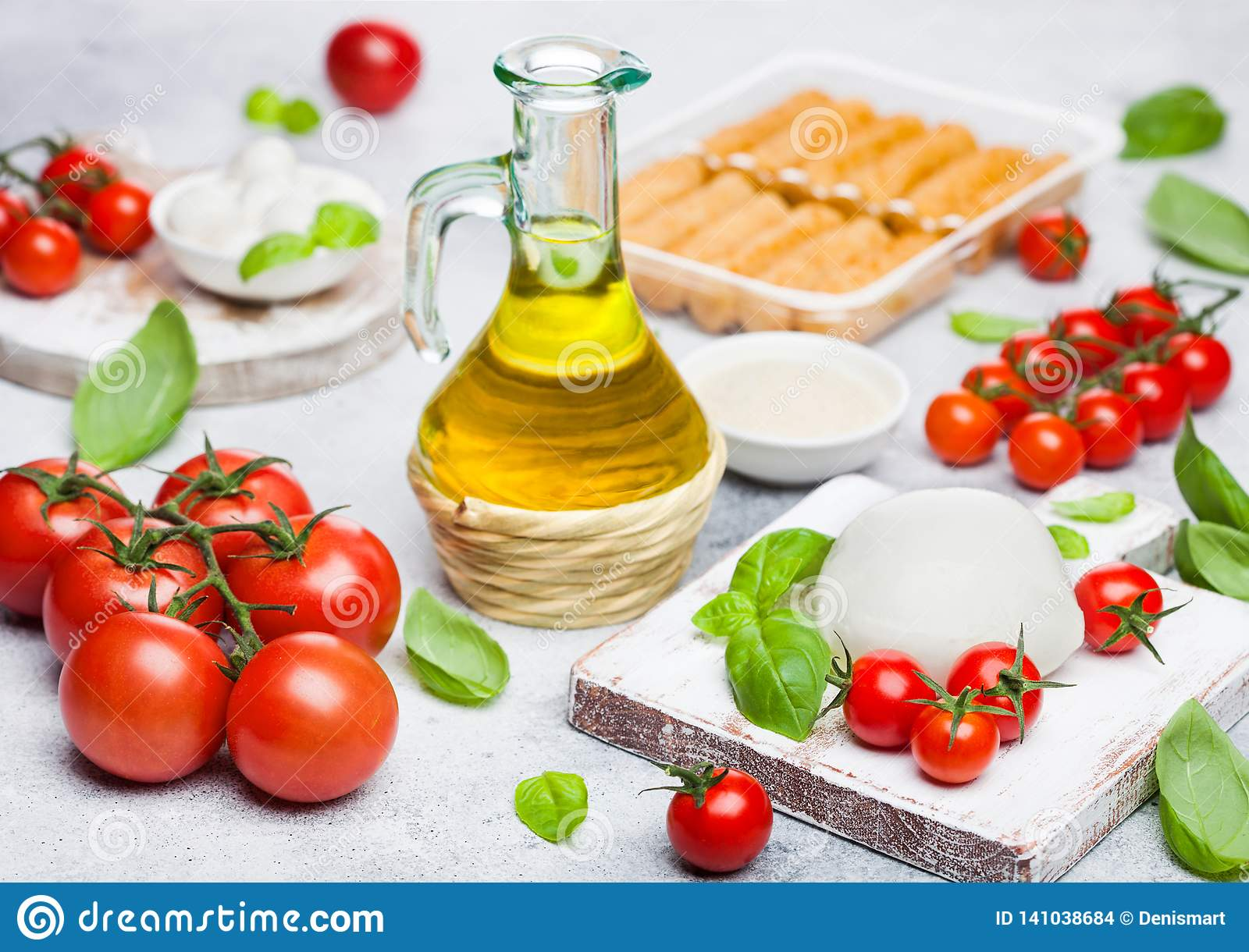 Fresh Mozzarella Cheese On Vintage Chopping Board With Tomatoes And Basil Leaf With Olive Oil And Tray With Cheese Sticks On Stone Stock Photo Image Of Fresh Deep 141038684