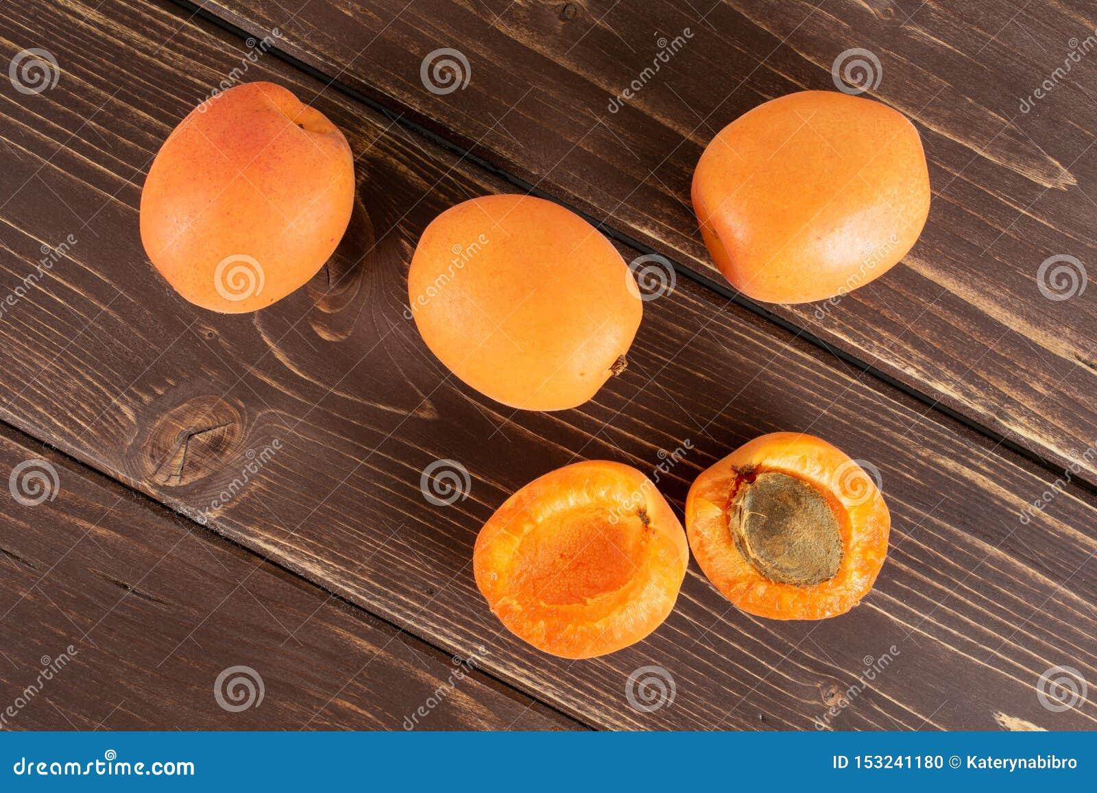 Fresh orange apricot on brown wood